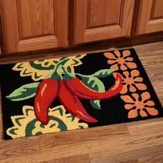 The Cayenne Peppers Kitchen Accent Rug will make your home too hot to handle! This attractive, thick, handmade rug features three red peppers with green leaves, set against a black background accented by floral designs in yellow and orange. Decor, Southwest Decor, Kitchen Flooring, Rugs, Handmade Home Decor, Kitchen Mats Floor, Home Decor, Handmade Kitchens, Kitchen Themes