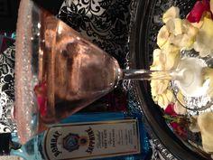 Rose Petal & Lychee Gin Martini with a Grenadine sugar rim.