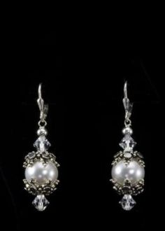 """Pearl Silver Earrings   12mm Swarovski pearls, Swarovski crystals, sterling silver bead caps and lever back hooks. Drop of 1/1-2"""". See matching necklace. http://www.sterlingjewelrystores.com/pearl-silver-earrings.html"""