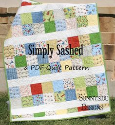 "Simply sashed is a great quilt pattern to use with all those great charm packs! With some simple sashing you will have a fun whimsy look! It makes a quilt top that measures 41"" x 52"". It requires 72 five inch charm squares, 2/3 yards sashing, 1/2 yard binding, 1 2/3 yards backing,"