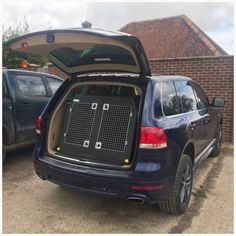 Volkswagen Touareg (2002–Present) Dog Car Travel Crate- The DT 11 About the Volkswagen Touareg (2002–Present) Dog Car Travel Crate- The DT 11 Our DT 11 DT Box is the perfect Dog Car Travel Crate for the Volkswagen Touareg (2002–Present). The DT 11 is a great dog transport box for large Jeeps with lots of space for two large dogs such as two German Shepherds. This box features a removable divider which when removed really opens it up into a massive box. The box is made from a super tough… Dog Travel Crate, Car Travel, Dog Transport, Pet Vet, Car Boot, The Perfect Dog, Stainless Steel Doors, Dog Car, Large Dogs
