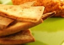 Sun dried tomato and garlic Hummus w/ Gluten Free Toasted triangles   I just found this and many more great recipes in Udi's Gluten Free Facebook App. Check it out for yourself!