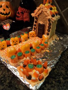 Halloween DIY:  How to Make a Graham Cracker (Faux Gingerbread) Haunted House.  Could use chocolate graham crackers for a spookier look.