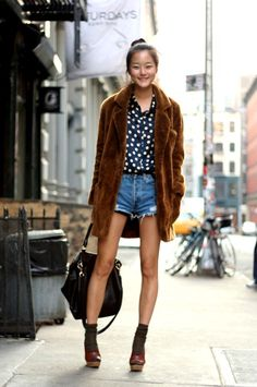 polka dot blouse, faux fur coat, and cut-offs make for a great casual chic look.