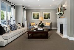 hamptons-style-living-room-with-fireplace-and-grey-armchairs