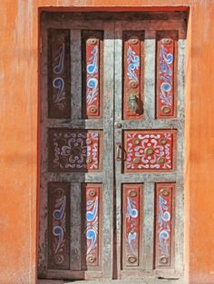 The doors on my grandmas house in mexico look like this but dark wood