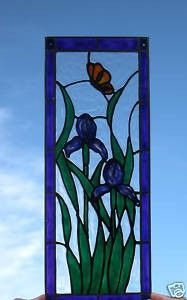 Long stem Irises and butterfly stained glass window. $23.00, via Etsy.