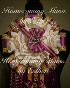 Homecoming mum, purple and gold.   https://www.facebook.com/Homecoming-Mums-by-Esther-273602849493591/
