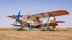 Agricultural aircraft parked on grass. Herbicide spray nozzles on lower wings. Airplane For Sale, Aviation, Royalty Free Stock Photos, Aircraft, Airplanes, Park, Vehicles, Grass, Image