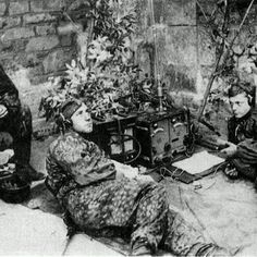 12th SS Hitlerjugend radio operators and their NCO inside the Abbeye D'Ardennen.(near caen) One of them wears the Palm Pattern smock while the other wears the Blurred Edge smock all of them wear dot 44 Pattern trousers. Taken in June 1944.