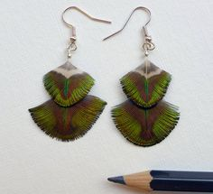 Check out this item in my Etsy shop https://www.etsy.com/uk/listing/255711963/peacock-shell-feather-dangle-earrings