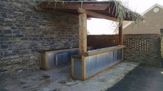 A new Tiki Bar just finished. Stone Masonry, Outdoor Kitchens, Fireplaces, Pond, Pergola, Outdoor Structures, Patio, Bar, Fireplace Set