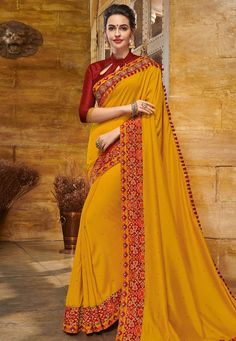 Merge tradition and modern fashion in this magnificent yellow color silk fabric traditional festive wear saree. Drape this saree at your upcoming ethnic functions with the matching traditional jewelry for a gorgeous look. Indian Sarees, Silk Sarees, Yellow Saree, Yellow Fashion, Party Wear Sarees, Blouse Online, Festival Wear, Saree Collection, Silk Fabric