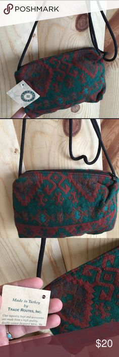 "Vintage Turkish crossbody purse / woven fabric Trade Routes brand made in Turkey crossbody purse. Woven traditional Turkish fabric, small size, purse is unlined. Thin black strap - 8.5"" by 5.5"" - strap is 24"" drop. Could knot if you prefer shorter. Thank you! Trade Routes Bags Crossbody Bags"
