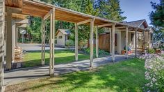 ~Covered walk way from the carport  2305 N Shore Rd, Bellingham 98226 Agate Bay Waterfront. Immaculate Waterfront home tucked in Agate bay with 100+foot dock