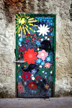 Painted flower door. Italy.... Paint murals on the ugly wood doors until we replace them with something modern? May not want to let them go then though! Hmmmm....