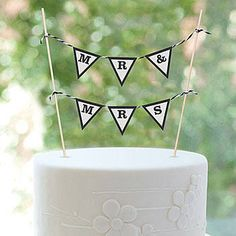 Create a unique look on your wedding cake with this Mr and Mrs banner from ShindigZ.com. Get a rebate from RebateGiant.