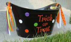 Halloween bucket- wonder if I could paint my blue plastic one???
