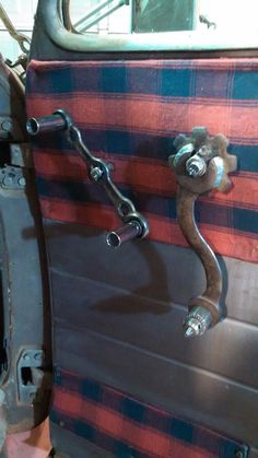 Custom window crank and inside door release using a combination of wrenches, drill chock, gear, and sockets.