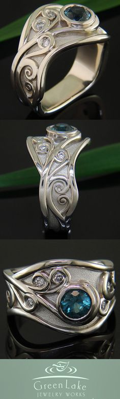 White gold and palladium wave ring with uniquely colored tourmaline center and diamond accents.