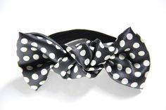 Bun bows are an easy and elegant way to sweep up your tresses when things get a little frizzy or if you're simply looking for a quick way to change up your look!  Bun Bows are made from luxurious fabrics, including crushed velvets, lamés, brocades and matelassés. They are hand knotted in North Carolina and made with coordinating fold over elastic.  Sassy style to upgrade your up-do!