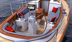 Morris yachts M46 is a modern design reminiscent of classic wooden runabouts.