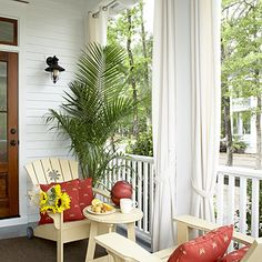 Pretty Back Porch with curtains and Adirondacks - Porch and Patio Design Inspiration - Southern Living