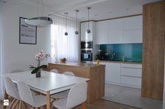 Mieszkanie w Iławie - Średnia otwarta kuchnia w kształcie litery l w aneksie z wyspą, styl nowoczesny - zdjęcie od Studio Projekt