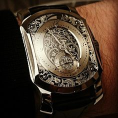 "...it isn't a watch . . . .this is ""Exquisite Art""...the disposable income you'd need to place an art piece like this on your wrist , is amazing , it really truly is. . .but then genius , WHO IN YOUR SOCIAL CIRCLE WILL APPRECIATE IT'S ""Filigree"" how thin and greatly detailed the face is ...  https://www.youtube.com/watch?feature=player_detailpage&v=UfGMj10wOzg#t=0"