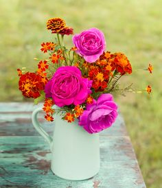 Mix an elegant flower like roses with the humble marigold for a striking mix. Details: http://www.midwestliving.com/garden/flowers/floral-arrangement-ideas/?page=3