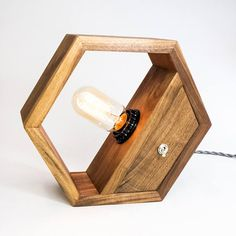 Light up your work or living space with this hexagonal hardwood edison lamp. American Black Walnut is one of my favorite hardwoods to use for my home decor products. It is a stable wood, has excellent warm brown coloring, and is heavy and solid. The 40 watt edison bulb emits a warm