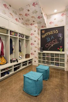 Family friendly mudroom features walls clad in Nina Campbell Aquarium Wallpaper lined with pale gray mudroom lockers boasting open and closed cabinets over stacked shoe shelves atop a polished concrete floor. Nina Campbell, Mudroom Cabinets, Mediterranean Style Homes, Wood Interiors, Cube Storage, Decoration Table, Concrete Floors, Bathroom Interior, Lockers