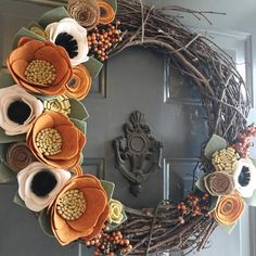 It's been gloomy and raining here today. I'm hoping this wreath brightens someone's day tomorrow! #feltflowers #feltflowerwreath #falldecor #fallwreath #customwreath #grapevinewreath #falldecor #porchdecor #buyhandmade #shopsmall #shophandmade #doordecor #etsymom #etsyshop #etsylove #fallfavorites #fallismyfavorite #pumpkinspice #creative #creativelifehappylife #craftymom #craftlove #craftsposure