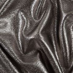 Introducing a fabulous metallic silver and heathered egret laminated French terry. French terry is a type of toweling fabric consisting of a flat surface on one side and uncut cross loops on the other. Featuring a metallic laminate on its surface, this terry is more upscale than your average toweling material. With a subtle stretch along the weft, use this glamorous terry for fashion forward sweatshirts, jackets and futuristic dresses.