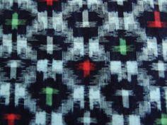 Vintage Japanese indigo kasuri (ikat) cotton, featuring red and green.