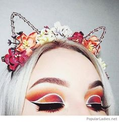 Colorful eye makeup and head accessory