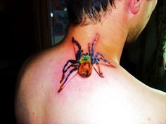 This tarantula neck tattoo looks a little too real for my taste. Have you seen all of the 20 Crazy Neck Tattoos?