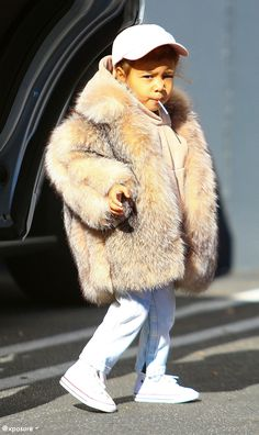 North West being cute in Converse.