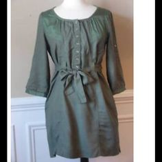 💥PRICE DROP💥 Trendy Green Shirt Dress Dark green shirt dress from Staring at Stars by Urban Outfitters. Sleeves can be 3/4 length or rolled up and snapped for more of a half sleeve. Snaps up the front and ties at the waist. Excellent condition with no flaws. 100% viscose Urban Outfitters Dresses