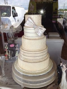ivory lace wedding cake with edible bow