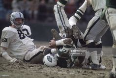 New York Jets QB <a gi-track='captionPersonalityLinkClicked' href=/galleries/search?phrase=Joe+Namath&family=editorial&specificpeople=91230 ng-click='$event.stopPropagation()'>Joe Namath</a> (12) on ground after being sacked vs Oakland Raiders Ben Davidson (83) at Shea Stadium. Flushing neighborhood of the Queesn borough of New York City Walter Iooss Jr. X13749 )