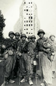 Red Army sappers pose in front of a Belgrade high rise after the battle for the city. The Germans extensively mined the capital of Yugoslavia and the sappers had their hands full. Note the rods they are holding, indispensable in the search for explosives in confined spaces. Oct 20, 1944.