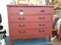 SOLD - While it looks like four drawer, it is actually a three drawer chest. Painted a rich red with black accents. Measuring 36 x 17 inches and stands 33 inches tall.  **** In Booth D8 at Main Street Antique Mall 7260 E Main St (east of Power RD on MAIN STREET) Mesa Az 85207 **** Open 7 days a week 10:00AM-5:30PM **** Call for more information 480 924 1122 **** We Accept cash, debit, VISA, Mastercard, Discover or American