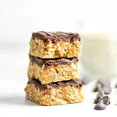 Chocolate Peanut Butter Coconut Bars! Peanut butter, honey, coconut and oats make the best healthy dessert! Gluten-free, dairy-free, and refined-sugar free!