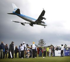 Dutch golfer Christel Boeljon (R) awaits her turn until the plane has landed during the womens Open golf tournament on the International Golf Course in Amsterdam, on May 24, 2013. BAS CZERWINSKI/AFP/Getty Images