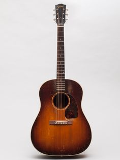 A 1949 Gibson J-45 used by jazzist Julian Lage. This J-45 has mahogany sides and walnut back, while usually the back is mahogany too since the J 45 introduction in 1942. This seems to be the only J-45 around today with this wood feature. You can see more at http://www.gbase.com/gear/gibson-j-45-1949-sunburst-1 and here http://www.julianlage.com/news/2014/12/31/1949-gibson-j-45-for-sale