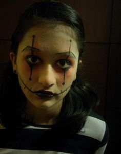 Quick and easy Clown makeup #super scary Put foundation  Put powder on ur face to make it white  Make triangles surrounding ur eyes using red eyeshadow  Put eyeliner ,and make long lines extending till ur eyebrows and till the end of ur nose  Put black lipstick and draw stitches  EASY AND SPOOOOOKY
