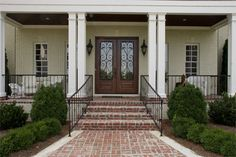 Appealing Brick Front Porch Steps With Iron Railing White Patio Chairs White Windows Frames Wall Mounted Lighting Glass Door Front Porch Railings, Brick Porch, Front Porch Steps, Patio Steps, Porch Columns, House With Porch, House Front, Balustrades Avant, Brick Steps