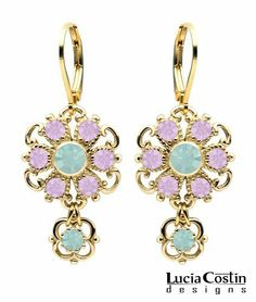 Lucia Costin Flowery Dangle Earrings Made of .925 Sterling Silver Plated with 14K Yellow Gold with Lilac and Mint Blue Swarovski Crystals and 4 Petal Fancy Flower, Etched with Twisted Line Accents Lucia Costin. $54.00. Update your everyday style with inspiration when wearing this piece of jewelry. Lucia Costin floral Dangle earrings. A perfect feminine touch. Beautifully designed with light amethyst and pacific opal Swarovski crystals. Unique jewelry handmade in USA