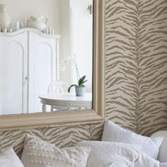 Animal prints are so in and I am in love with this one and zebra. I think I would love to do this in my half bath..